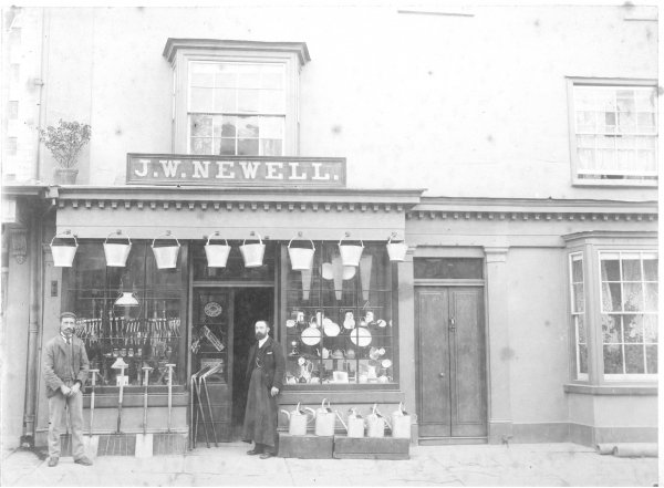 John W Newell outside his shop
